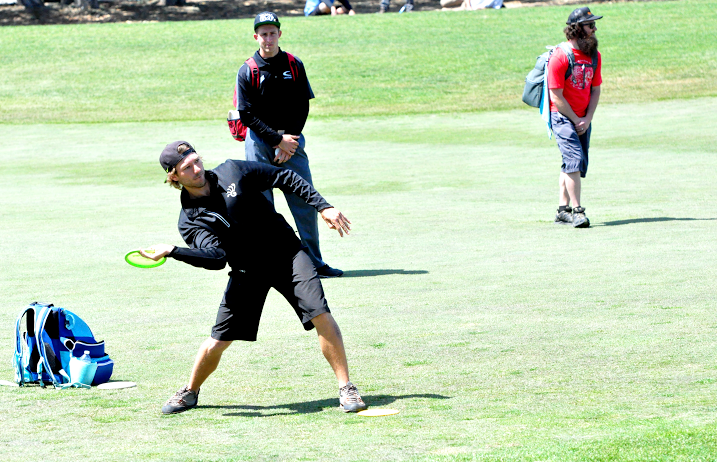 Jared Roan approaches as Ricky Wysocki looks on at the St. Jude Disc Golf Charity Invitational. Photo: PDGA