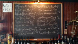 The Dive Bar's handwritten tap list adds to the venue's overall vibe.