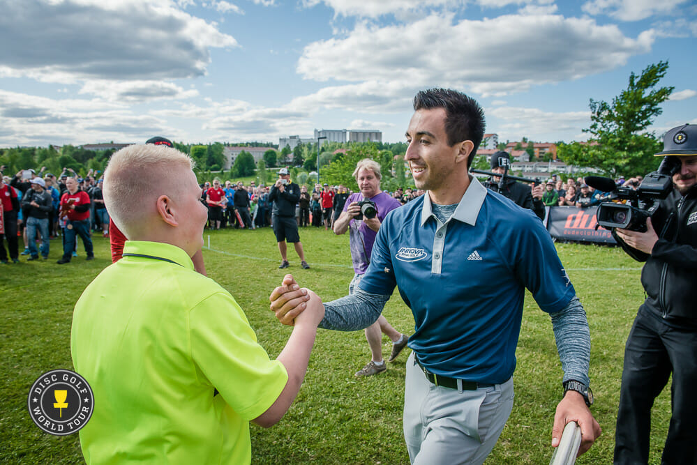 Paul McBeth celebrates with his caddy after coming back to win the European Open by two strokes. Photo: Eino Ansio, Disc Golf World Tour