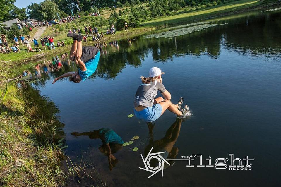 Bradley Williams (left) and Paige Pierce celebrate their Vibram Open victories with the traditional pond jump. Photo: Stu Mullenberg, The Flight Record