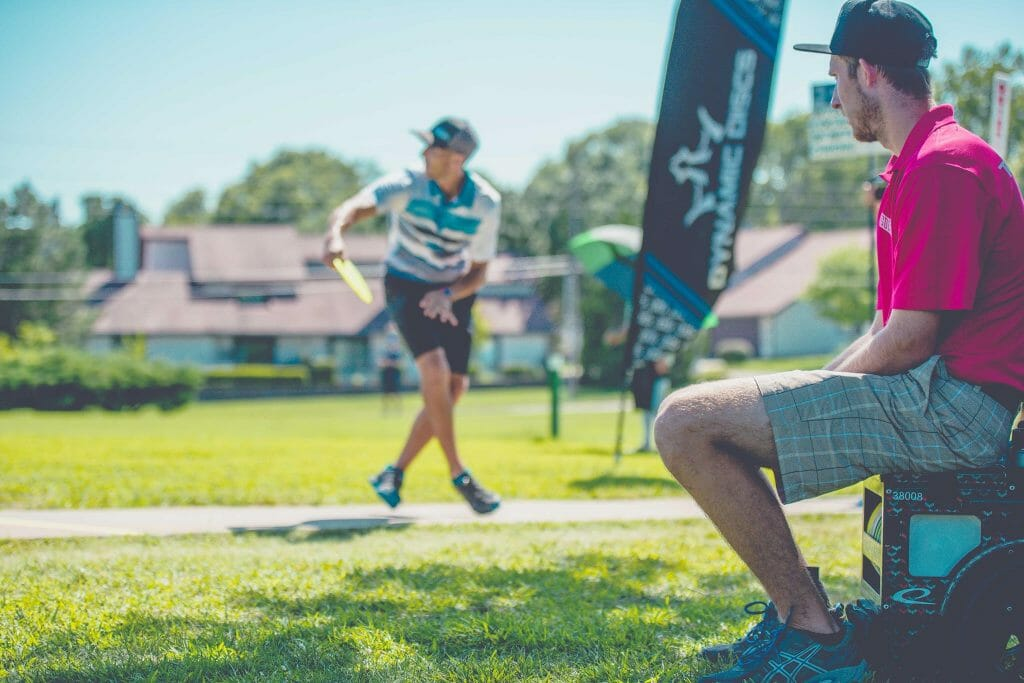 Ricky Wysocki looks on as Paul McBeth drives at the Emporia Country Club Thursday. Photo: Juan Luis Garcia, Overstable Studios
