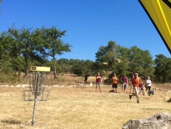 Texas' Name Here launches a 40-foot putt to force a playoff at the Texas Collegiate Disc Golf Championship. Photo: Jay Reading