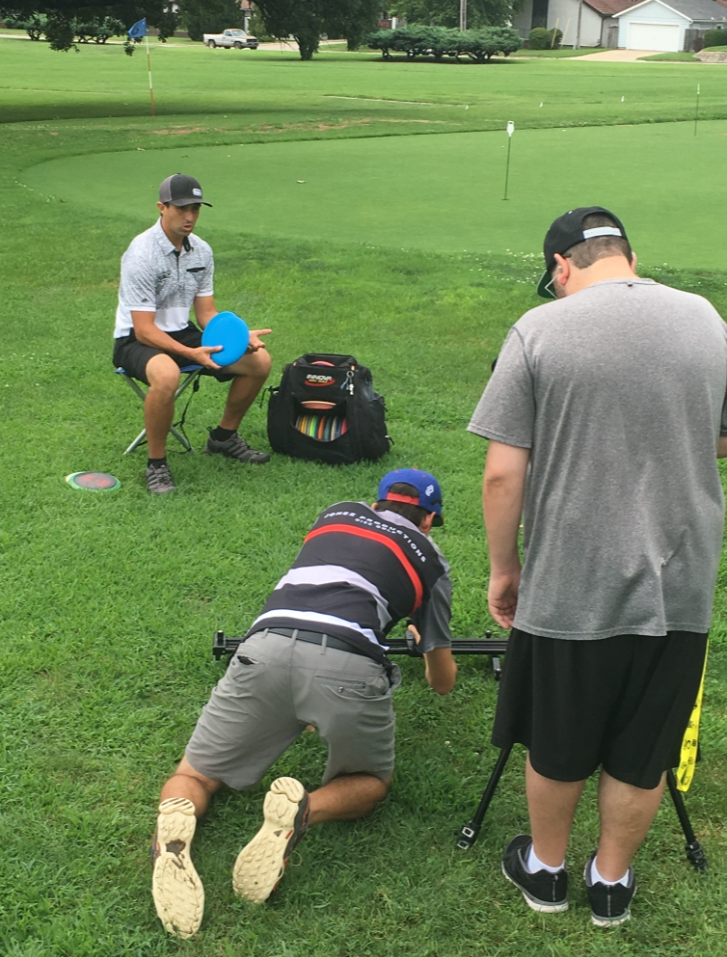 "Jonathan Gomez (middle) and Michael Fouche (right) film their Paul McBeth ""In the Bag"" video before Pro Worlds. Photo: Jomez Productions"